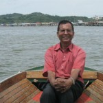 Boating at Brunei River near Floating Villages