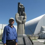 Chernobyl Monument near covered Reactor that exploded